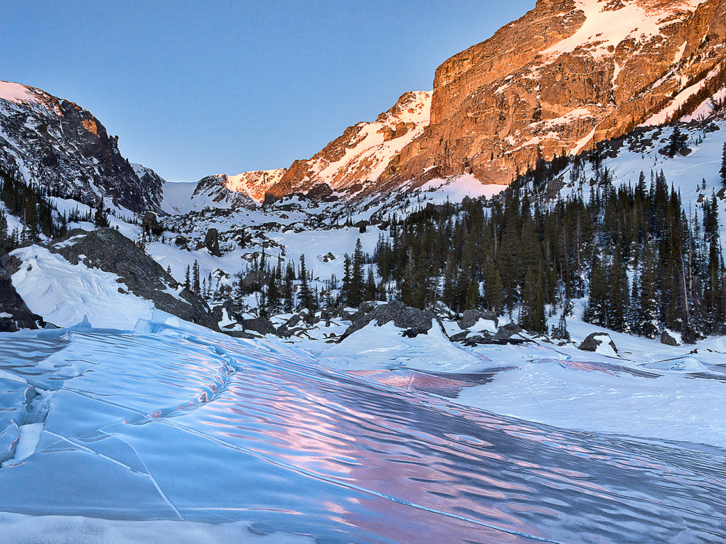 Be sure to bring a camera to capture stunning winter landscapes in RMNP.