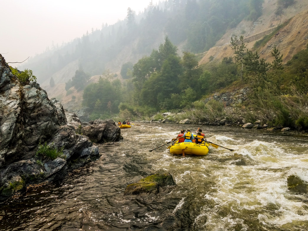 Rafters paddle on after making it through the Endless Summer wave on the mighty Klamath River. Centrally located on a long whitewater stretch of California's second-largest river, Happy Camp is an excellent launch point for multiday packrafting trips.      Dylan Jones