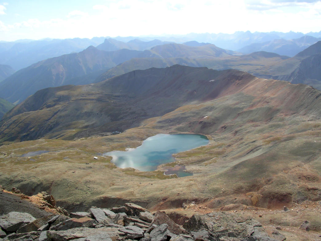One of the upper feeder lakes and old cabin above Ice Lakes Basin, seen from Golden Horn.     James Dziezynski