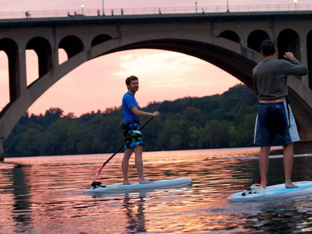 Locals enjoy a sunset paddle at the Key Bridge Boathouse in Georgetown