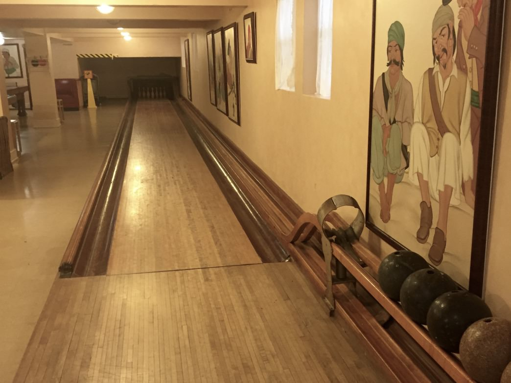 The Reynolds Mansion game room features a billiards table and bowling alley.
