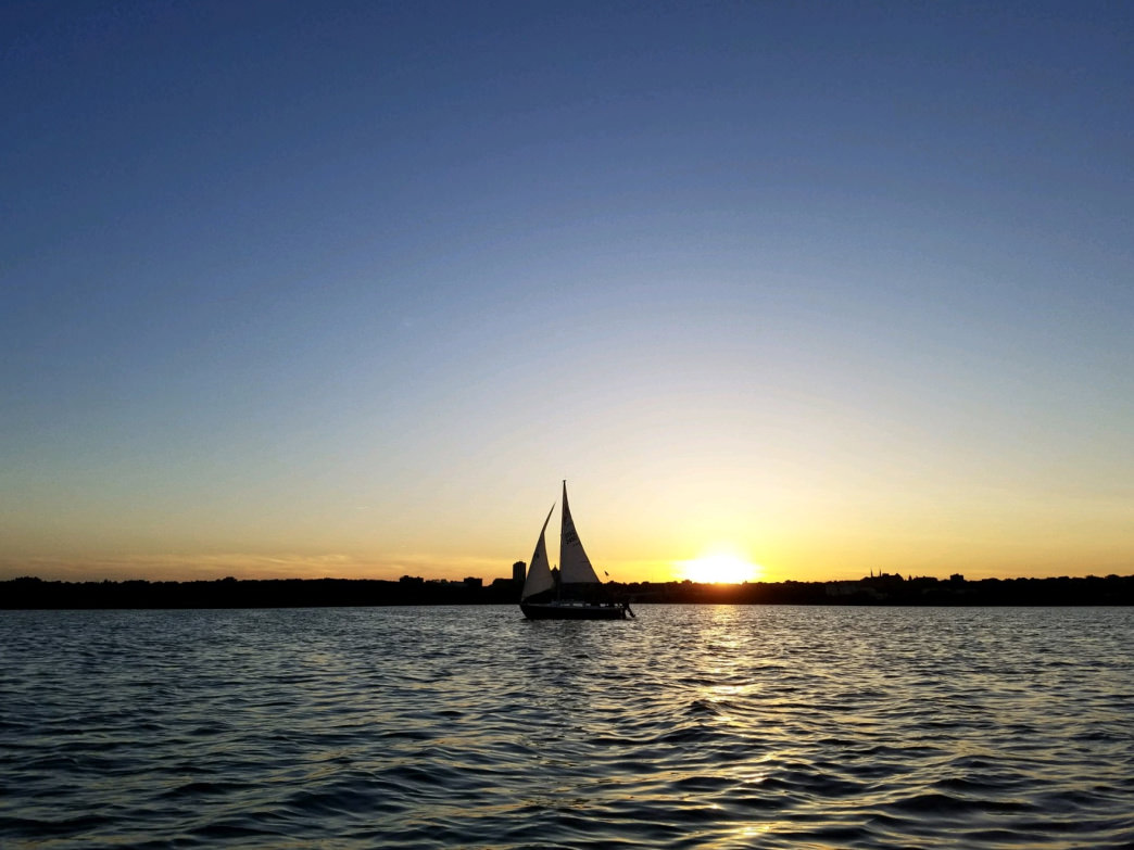 A sailing cruise on the Illinois River provides sunset views of the city.     Juniper Rose