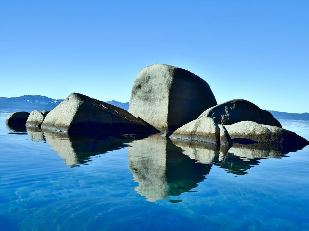 The stunning rock formations in the calm, crystal clear waters of Lake Tahoe make for a paddler's paradise.     Aaron Hussmann