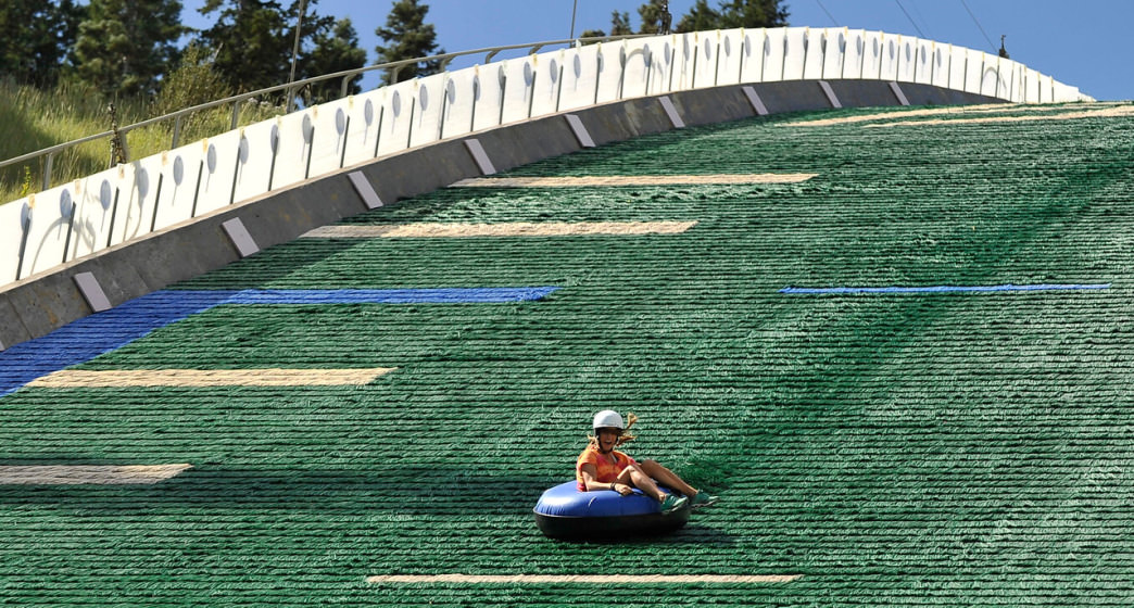 Extreme tubing takes riders down the landing hill of the ski jump.