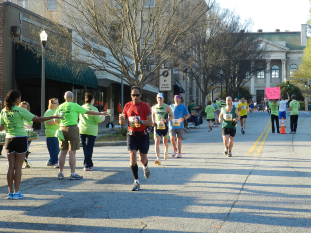 The Georgia Marathon runners in downtown Decatur