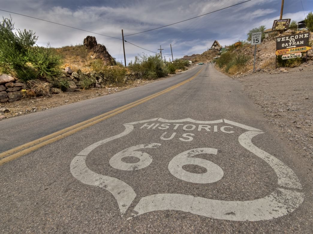 A painted road sign along Route 66.
