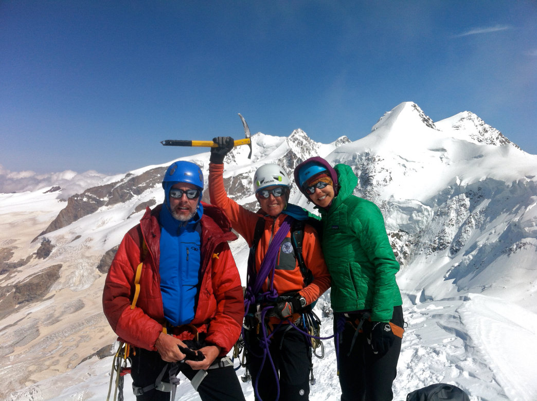 Hawse, center, poses with her guests on the summit of the Breithorn above Zermatt, Switzerland, guiding the Half Traverse.     Angela Hawse
