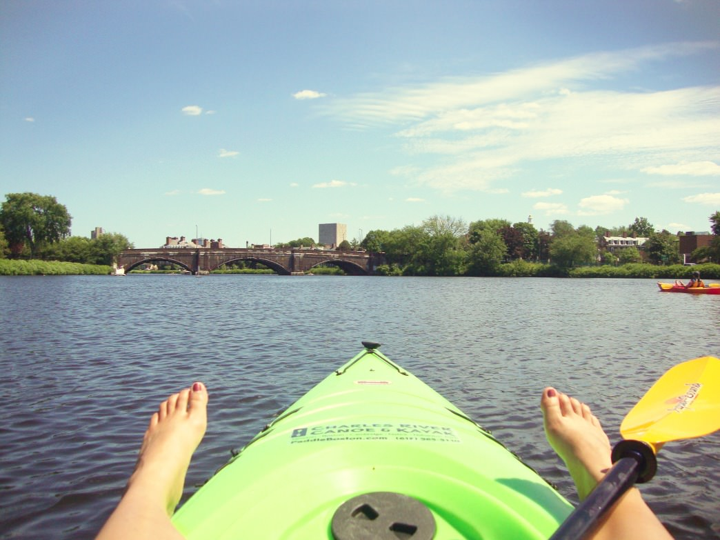 Paddling along the Charles with my feet out