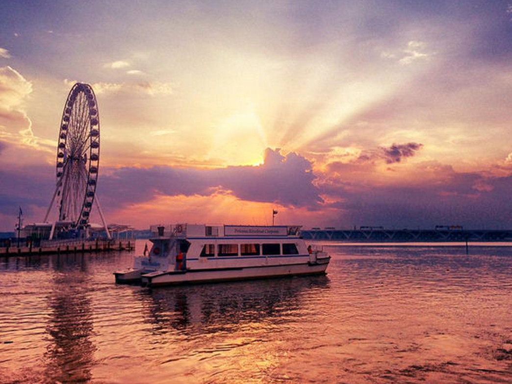 River cruise on DC's National Harbor at sunset