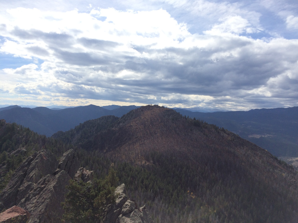 From the top of Bear Peak, you can see South Boulder Peak's burned summit to the south. Don't worry: It's closer than it looks.
