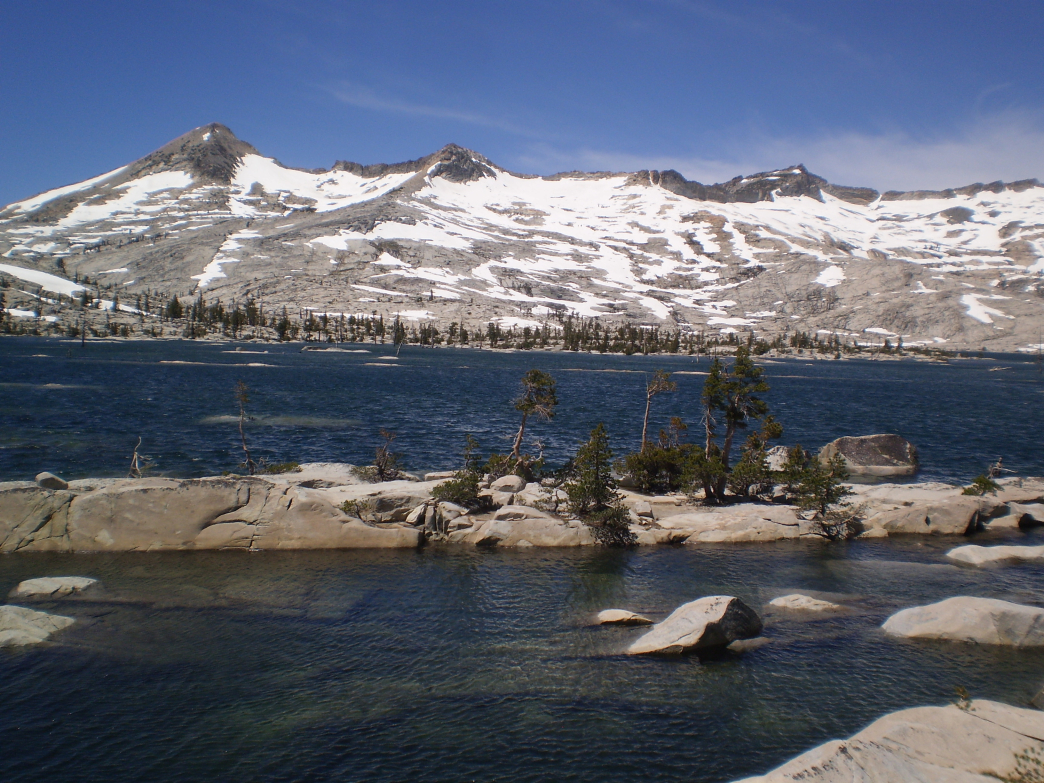 Lake Aloha contrasts with the marble white of the Crystal Range