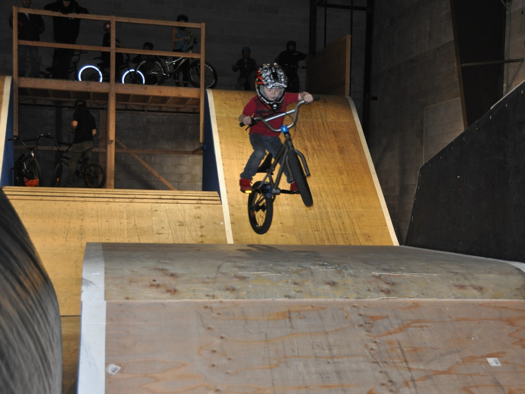 A grom learns how to get in the air on the intermediate jump line. Photo - Wasatch Indoor Bike Park