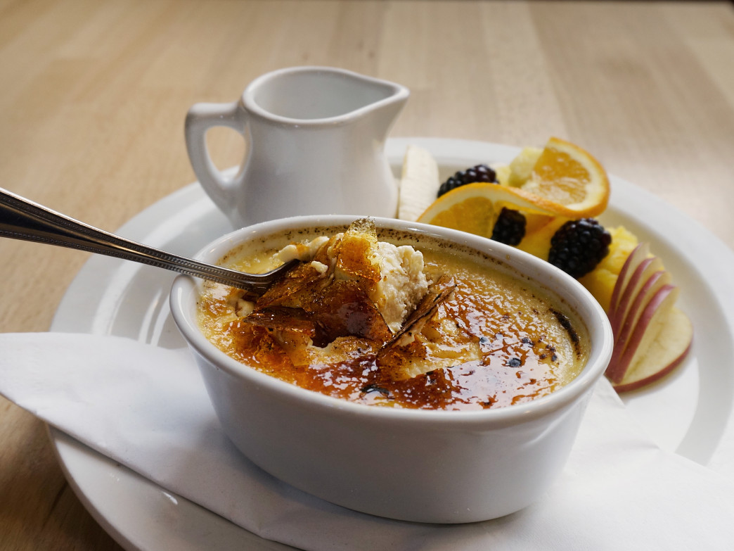 Warm Oatmeal Brulee, a seasonal offering at Sunny Point Café,  is crafted with organic oats with a rich custard top, served with cream and a side of  fresh fruit.