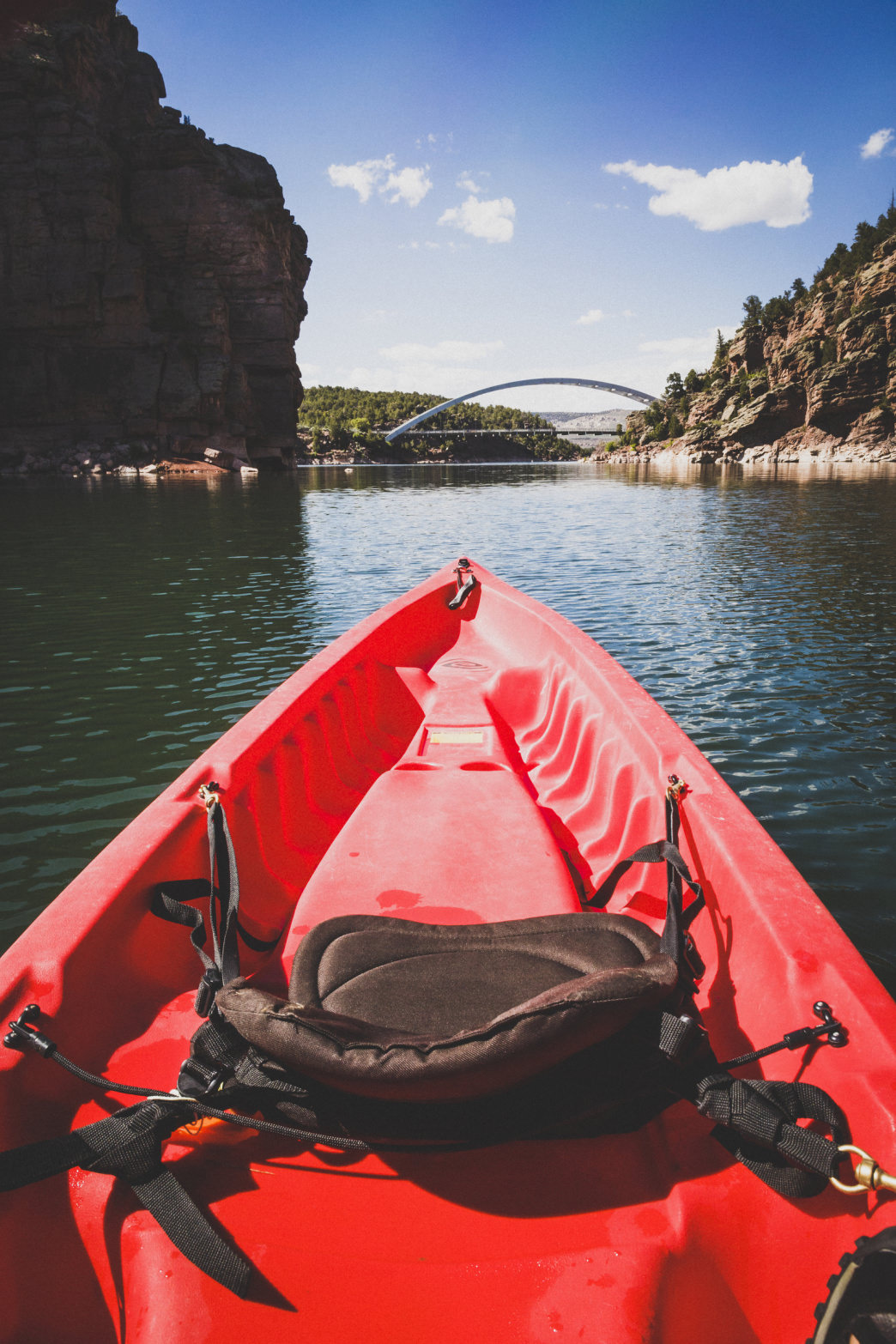 A kayak makes its way across Cart Creek Canyon, Flaming Gorge Reservoir, Utah.