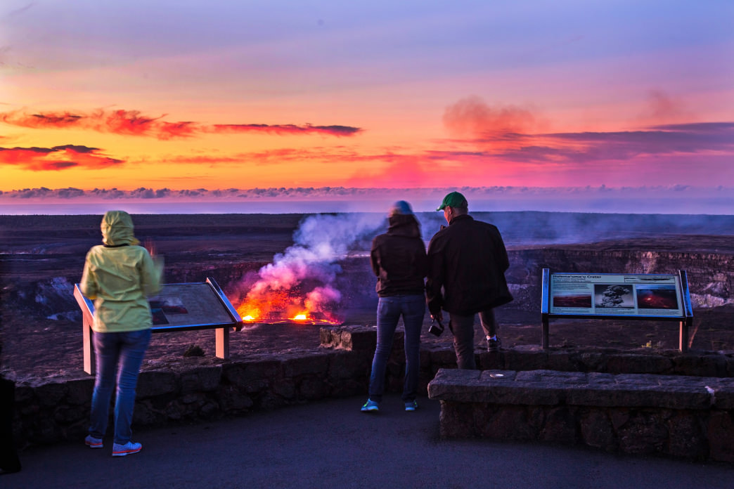 Watch sunrise over the fiery Halema'uma'u Crater at Hawaii Volcanoes National Park.