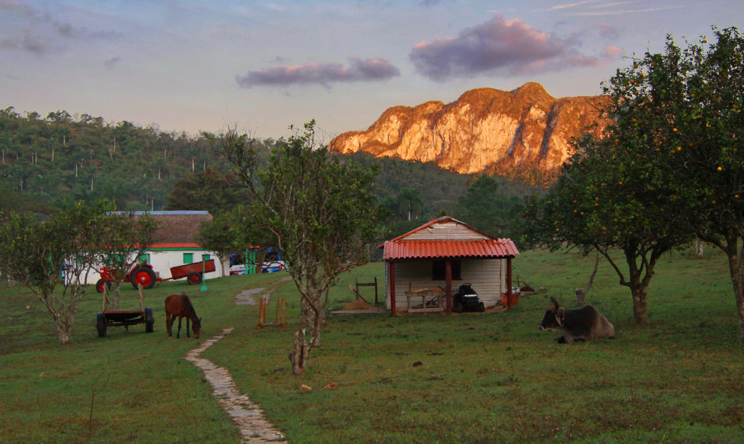 The sun sets in the Cuban countryside.