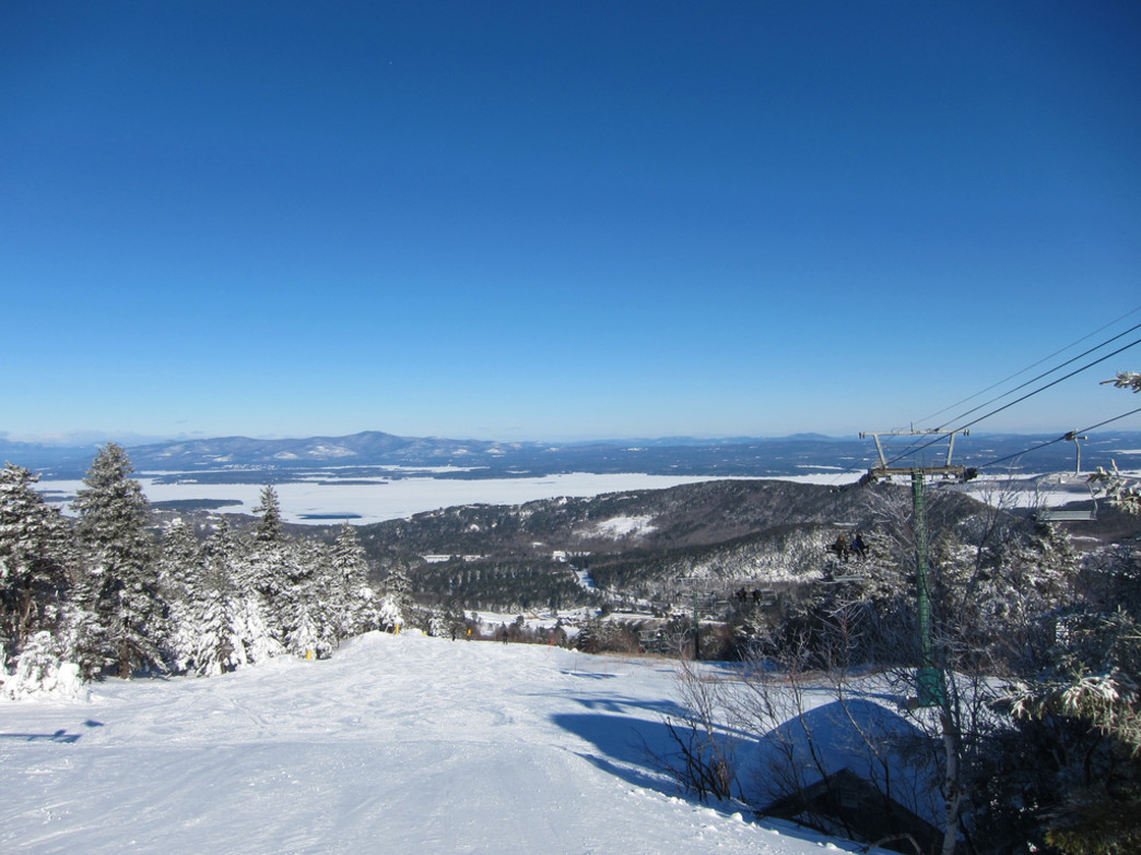 The view of mostly frozen Lake Winnipesaukee from the top of Gunstock