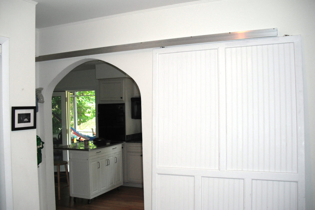 Consider a sliding barn door as a cool indoor feature.