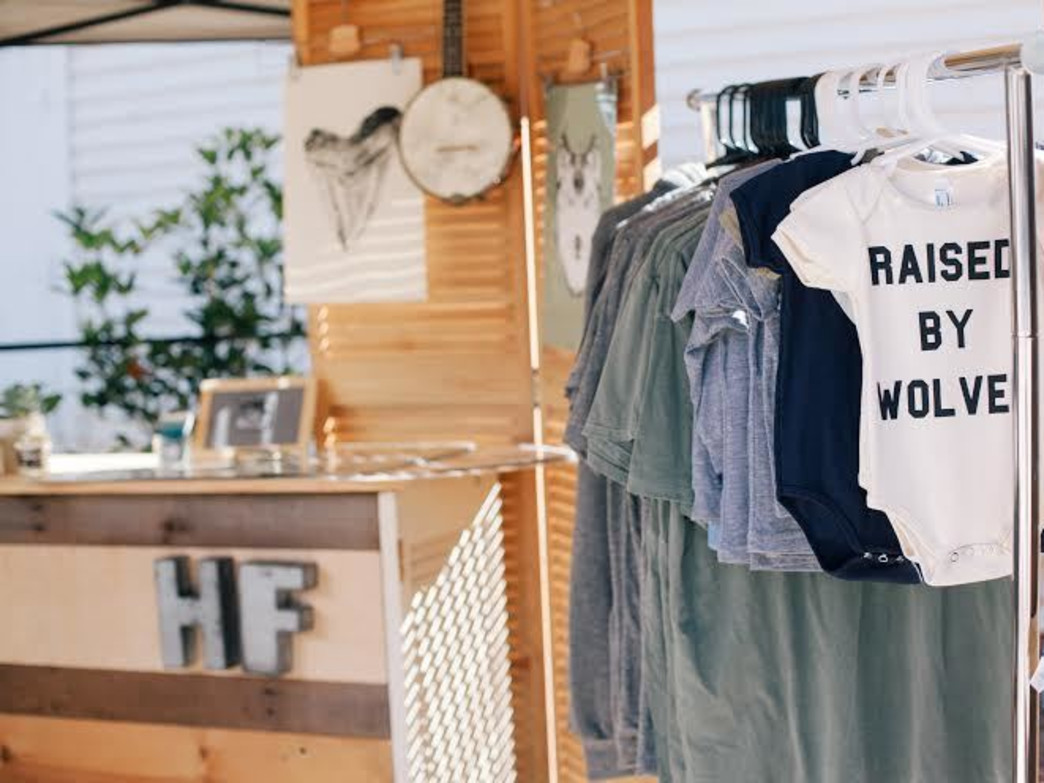 Hand printed clothes and goods by Holdfast Outfitters on display at an Asheville pop-up shop.