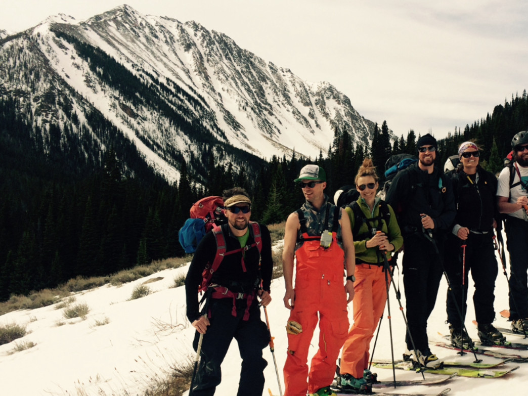 A group of intrepid skiers leaves civilization for five days of skiing the famed couloirs in the distance.
