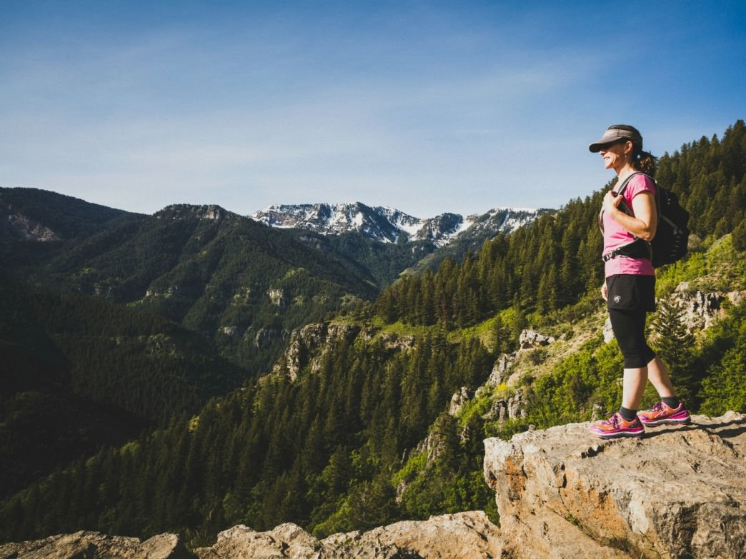 A woman enjoys the view of Logan Canyon during a hike, Utah