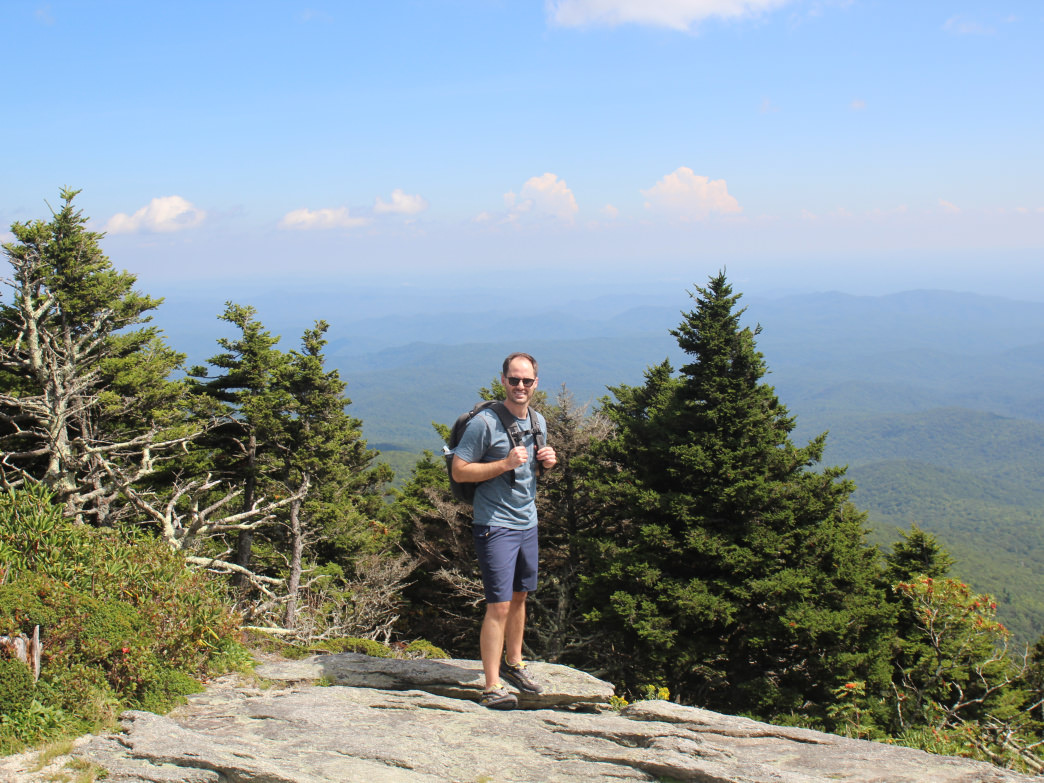 Dr. David Anderson at the top of Grandfather Mountain.