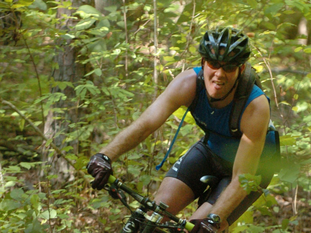 A mountain biker competes on the Swayback Bridge Trail during the Coosa River Challenge.