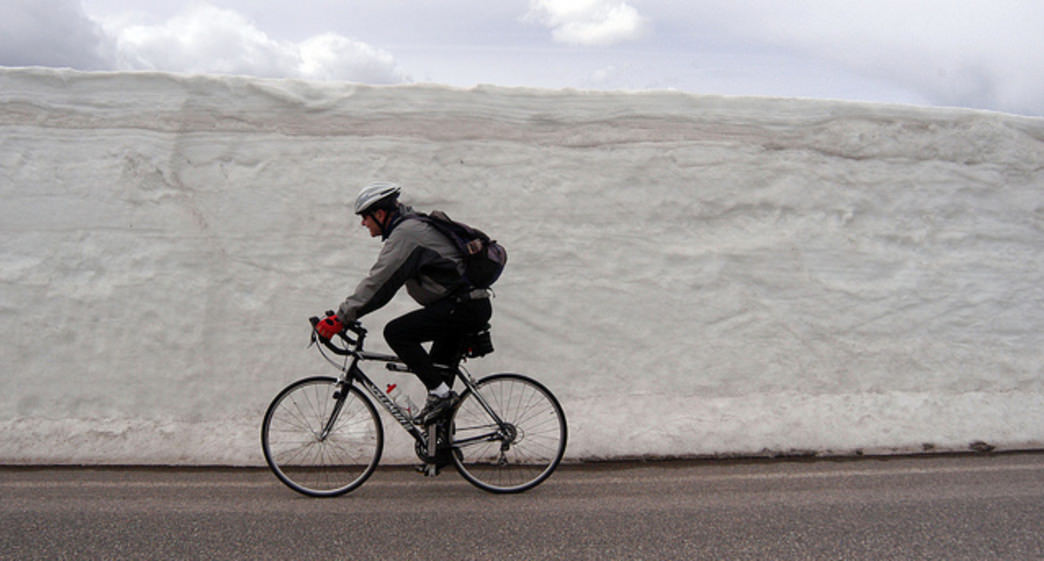 Spring is a great time for a road bike in Yellowstone National Park, though sometimes the plow leaves quite the tunnel.