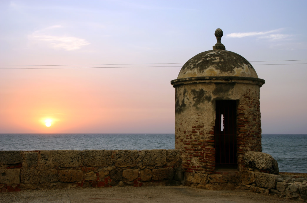 The sun sets on Cartagena, a must-visit city in Colombia.