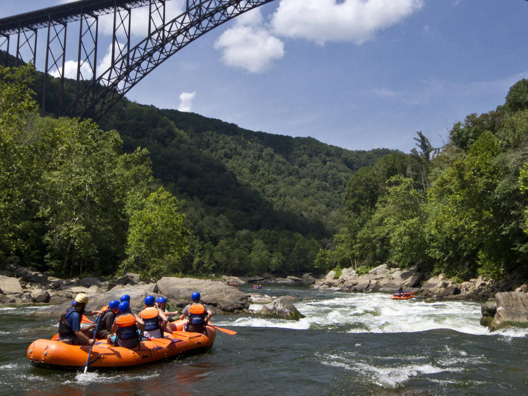 A commercial raft makes its way into Fayette Station Rapid under the iconic New River Gorge Bridge. Level: .5 feet.