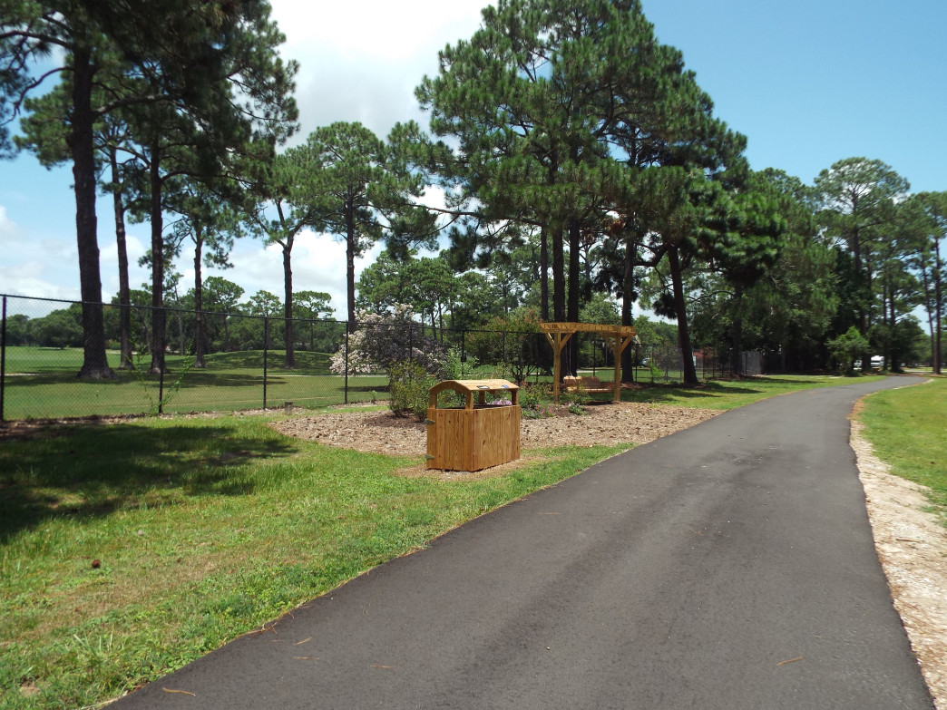 Swings and recycle bins are placed along the Fort Morgan Bike Trail are carefully decorated to blend in with natural settings.