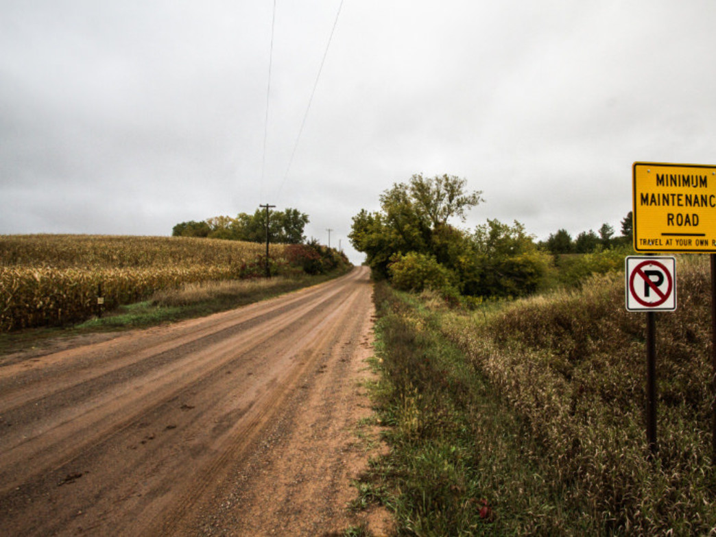 Gravel Road stretches to the horizon through Wisonsin Corn Fields, Courtesy of John Schletty