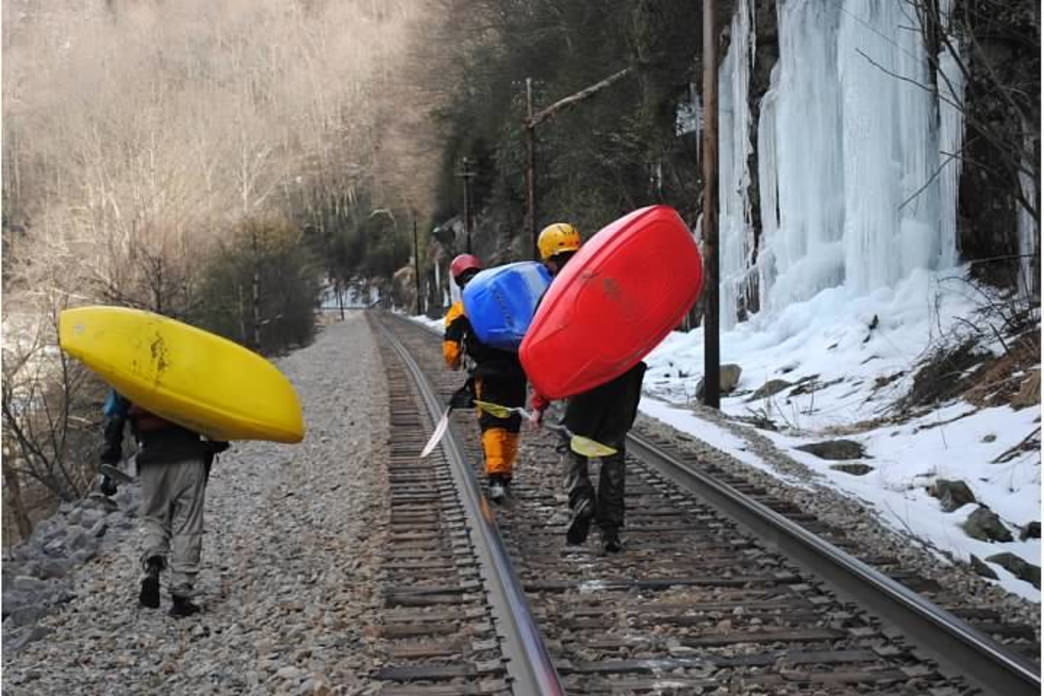 Kayakers walking the shuttle on the Nolichucky River.