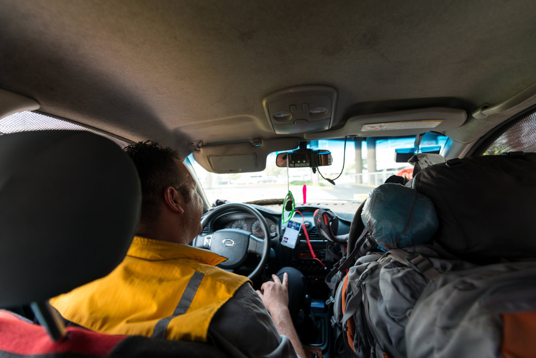 Communicating with the cabbie outside of SCL, Santiago, Chile.