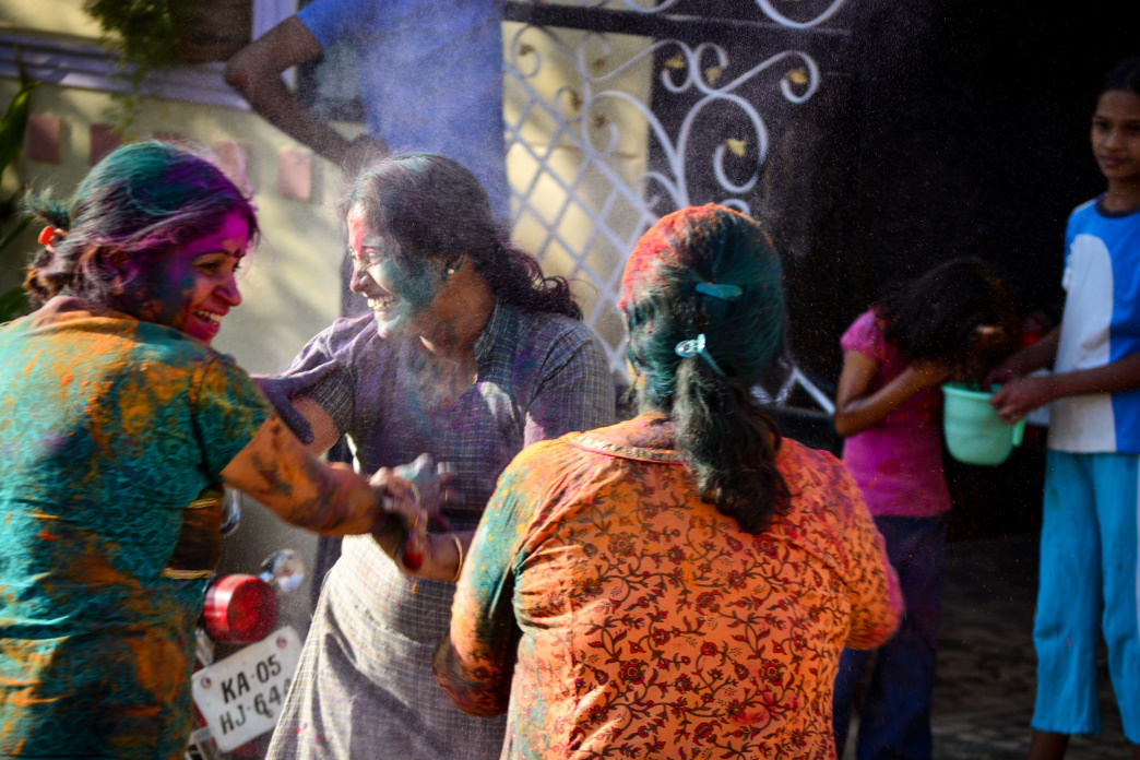 The colorful faces of women celebrating Holi.