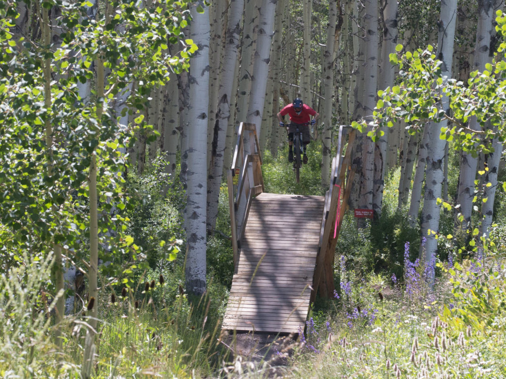 Steve Karczewski pedals around one of the banked turns on the lower Valhalla trail on Snowmass which is know for its progressive downhill trails.