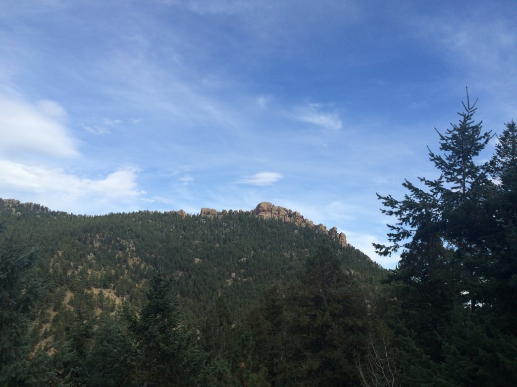 The west side of Bear Peak lacks the pointy tip you see from the east.