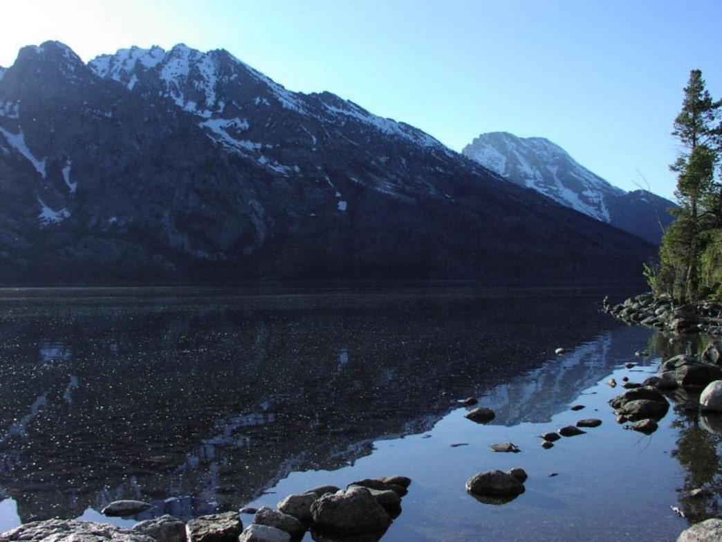 Enjoy a stroll around Jenny Lake before the crowds come to town.