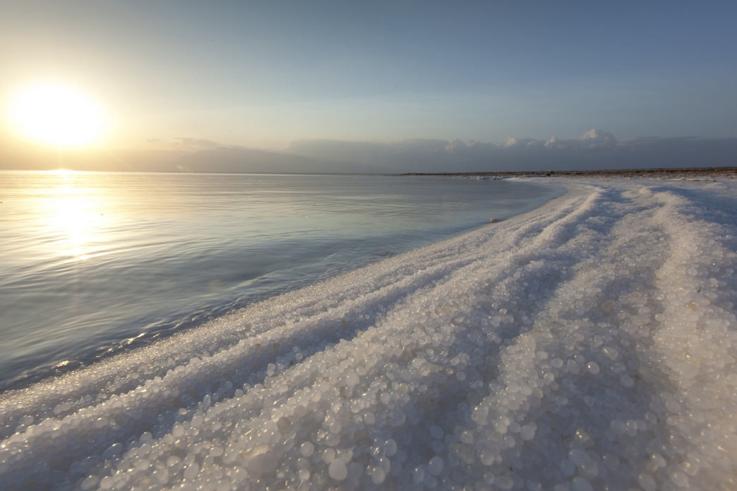 The salty shores of the Dead Sea seem to belie reality.