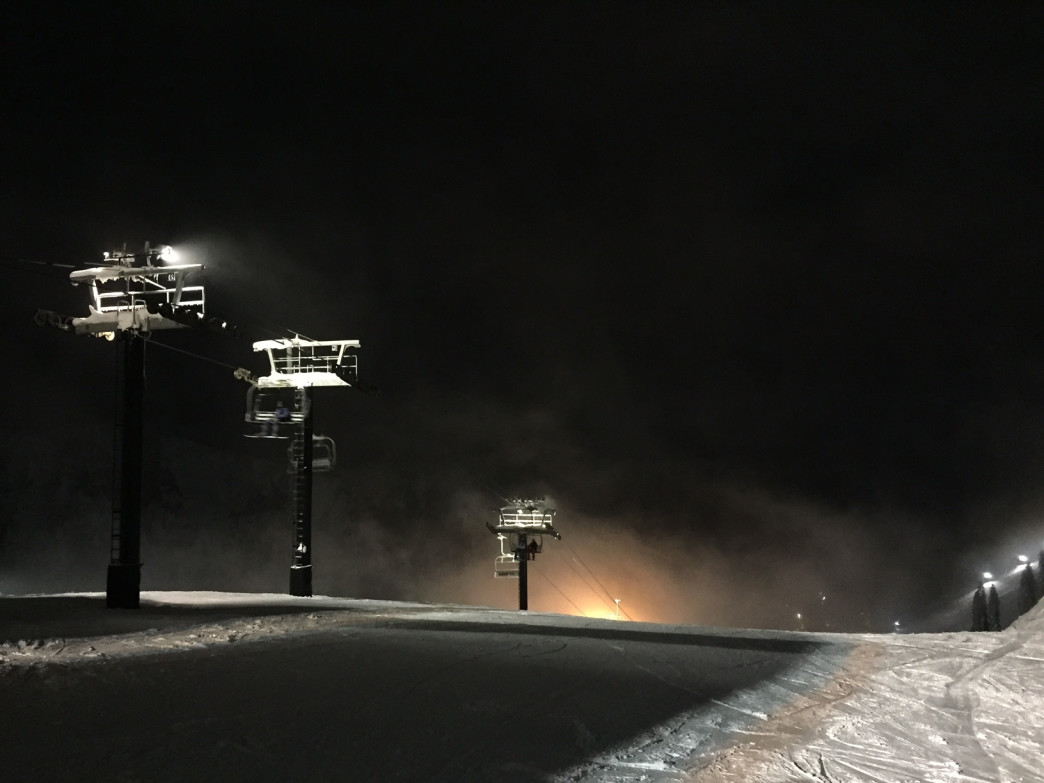 Skiing at night has an eerie atmosphere that is loads of fun.