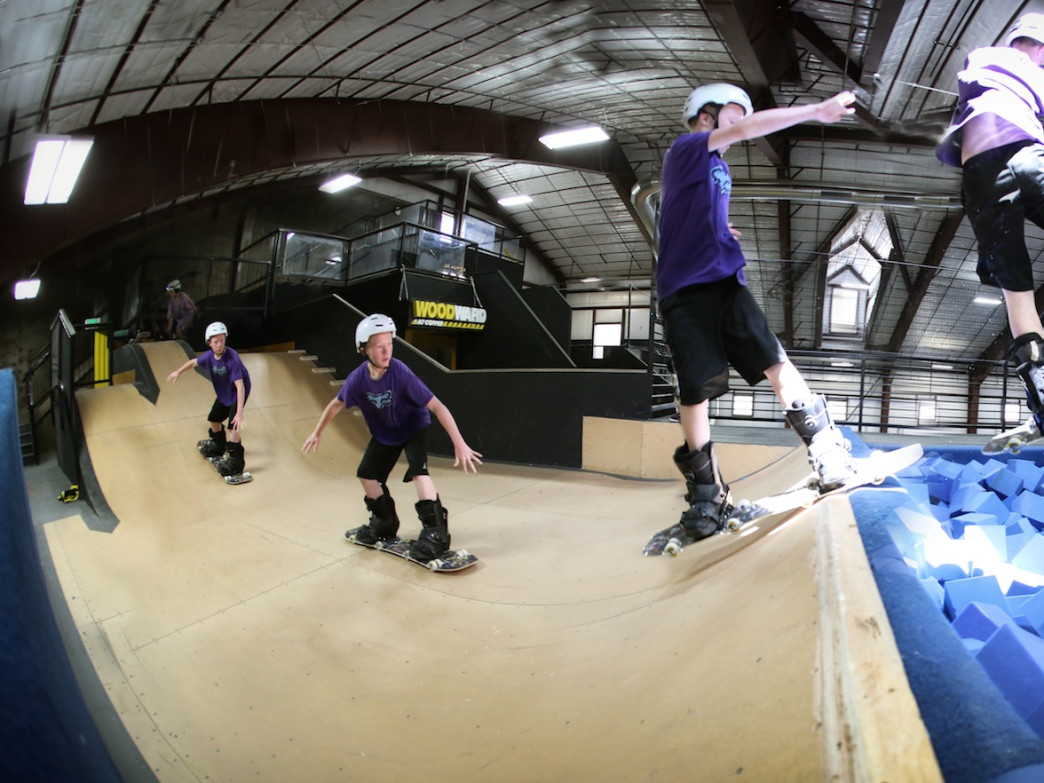 Practice tricks over foam pits at the indoor freestyle training facility at Woodward Copper.
