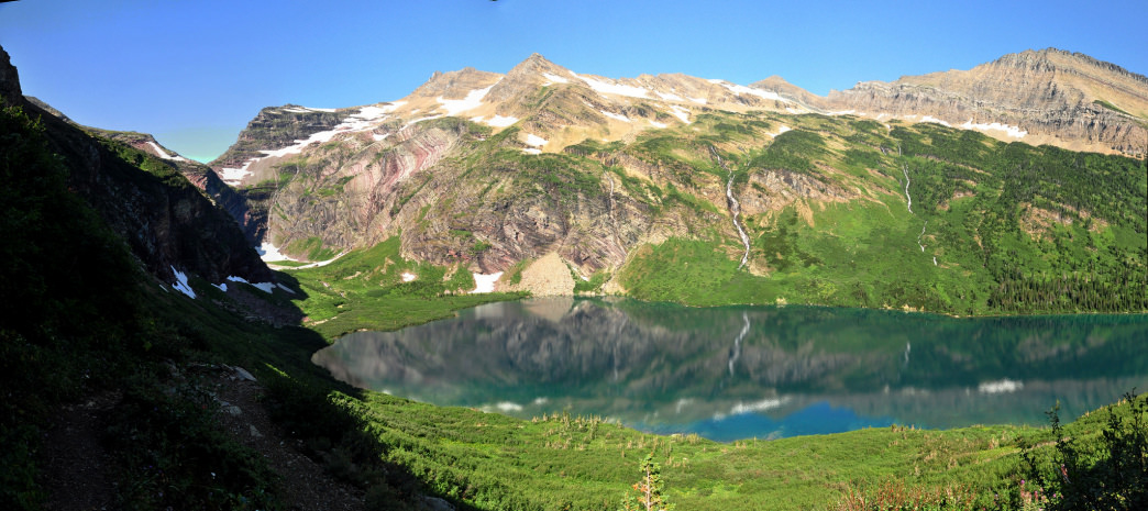 Gunsight Lake in Glacier National Park is turquoise due to suspended glacial flour.