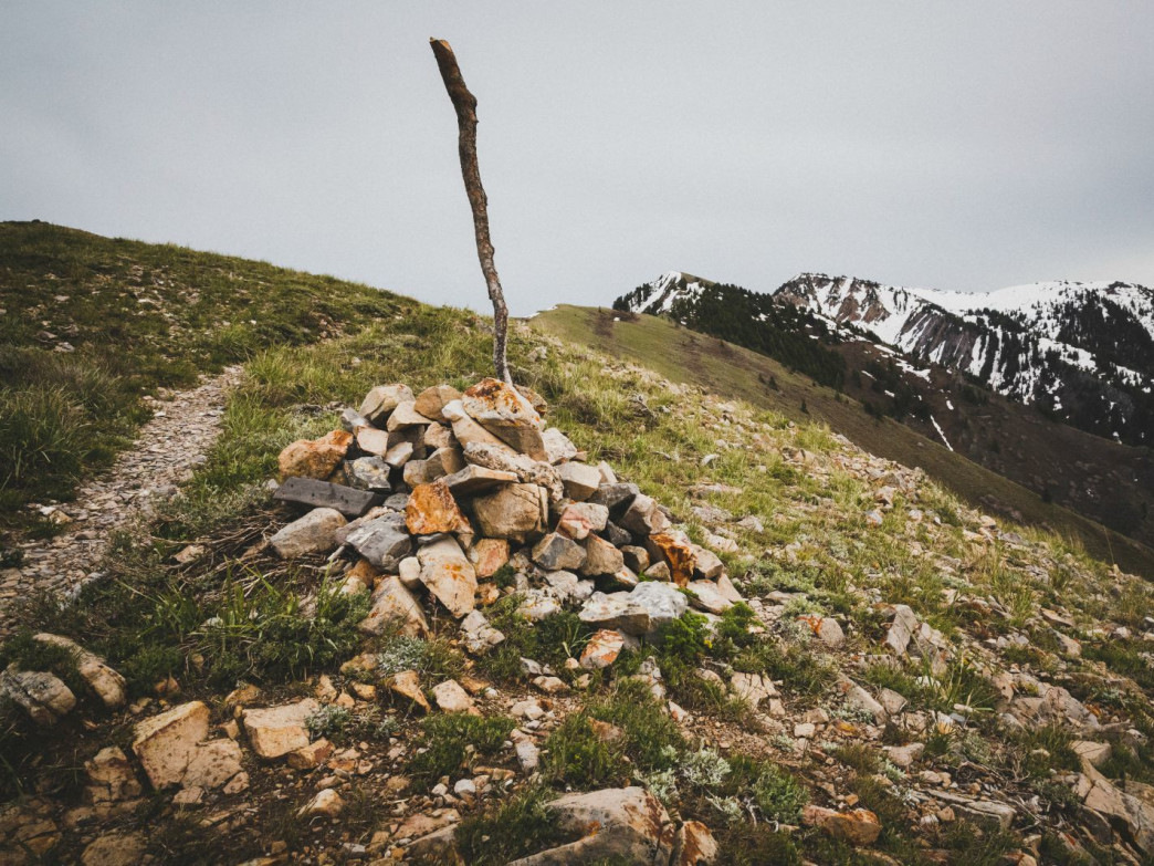 A cairn marks the intersection of Stewart Pass from the ridge leading to the Wellsville Cone and Box Elder Peak, Wellsville Mountain Wilderness, Utah