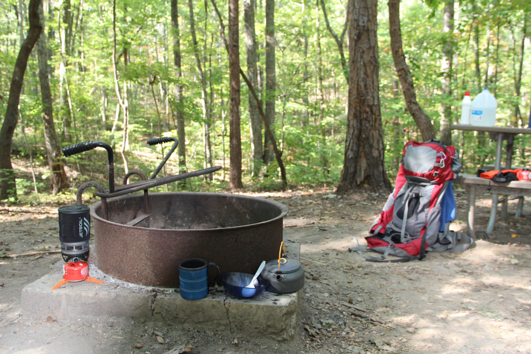 Family-camping sites include a fire ring and a picnic table. 