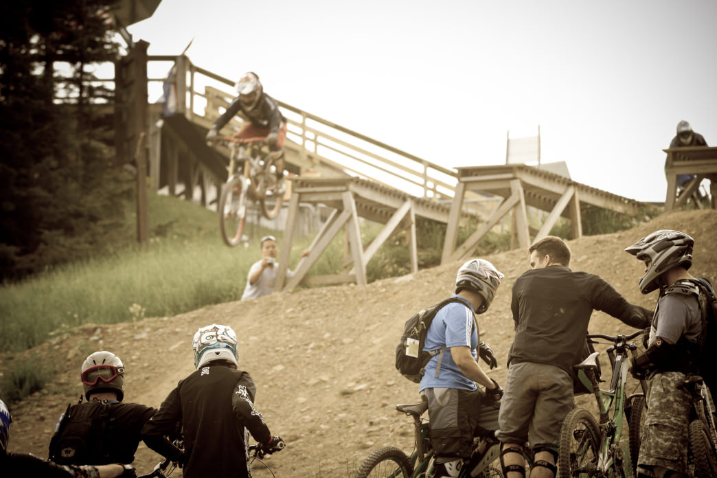 Taking a jump at Snowshoe Bike Park.