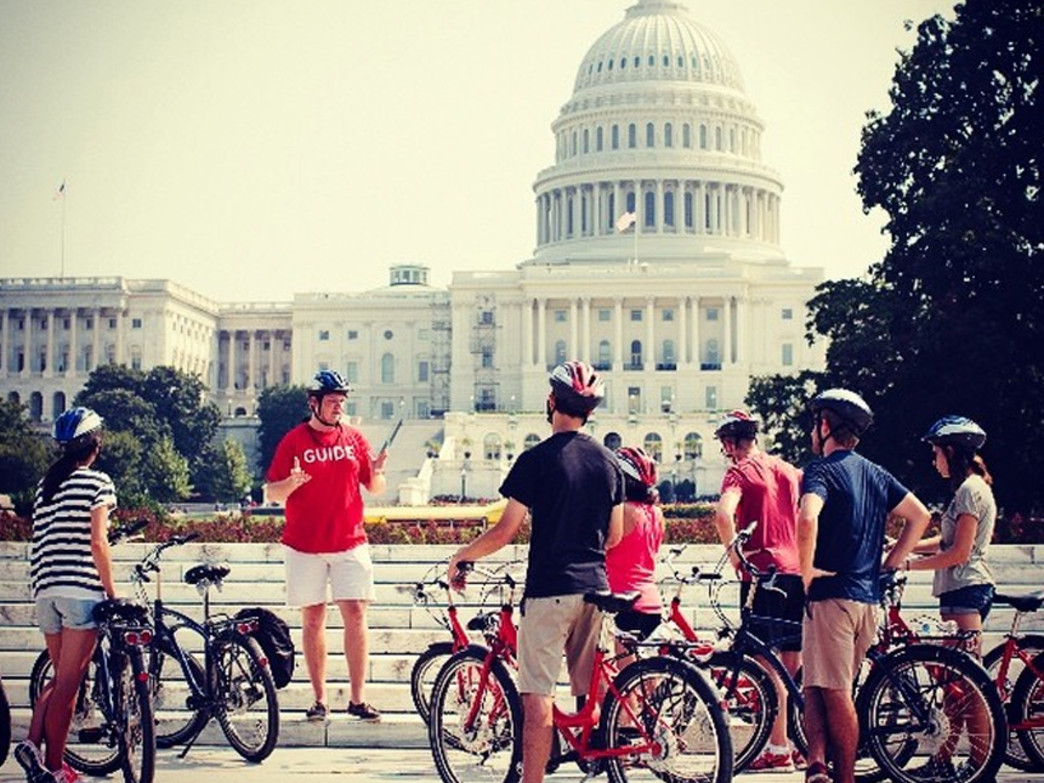 Bikers learn the history of the Nation's Capital in front of the U.S. Capitol Building