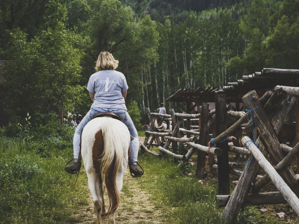 Lottie Dunnell rides a horse in the Wasatch-Cache National Forest, Utah.