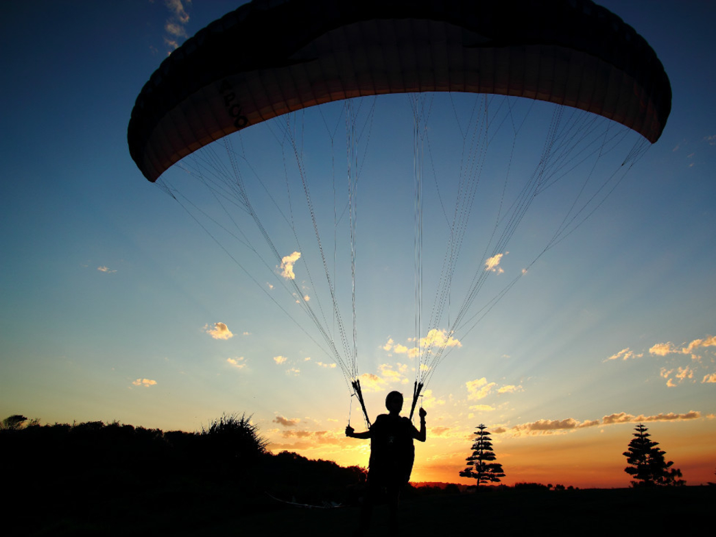 Paragliding in summer can mean seeing beautiful sunrises and sunsets.