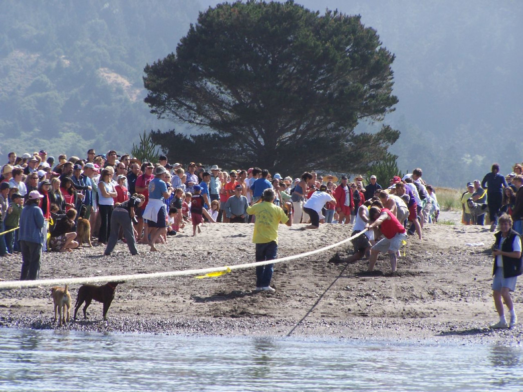 The tug of war is a spirited 4th of July tradition between these two small towns.