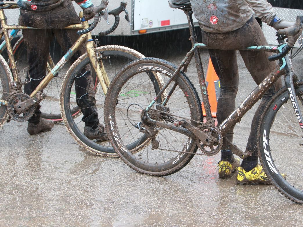 Racers wait to be hosed off after a muddy day on Jan. 10, 2015, at Zilker Park in Austin, Texas during the USA Cycling Cyclocross National Championships.